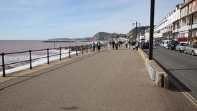 Sidmouth Devon England people walking on the prom stock video footage