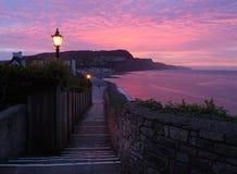 Sidmouth em Devon pela luz solar Fotografia de Stock Royalty Free