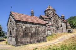 Sidofasad av kloster Gregory illuminationsenheten och gaviten av StNshan i Haghpat Arkivfoto