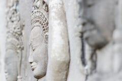 Sidoframsida av felik lättnad i Angkor Wat Fotografering för Bildbyråer