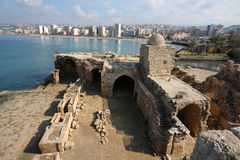 Sidon Crusader Sea Castle, Lebanon. Old and new come together as the ancient sea castle looks out onto the modern city Stock Image