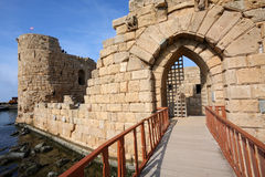 Sidon Crusader Sea Castle, Lebanon. Crossing over the bridge to the entrance gate of the Crusader Sea castle in Sidon, Lebanon Royalty Free Stock Photos