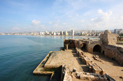 Sidon Crusader Sea Castle, Lebanon. Old and new come together as the ancient sea castle looks out onto the modern city Stock Photography