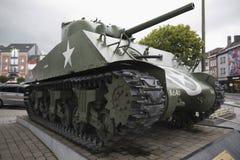 Sidosikt av den Sherman behållaren av den 11th Aroured uppdelningen på ställeGenen McAuliffe Arkivfoton
