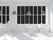 Sidosikt av ett vitt kontor av ett företag med en två stor tabell, två datorer som står på dem, ett panorama- fönster och royaltyfri bild