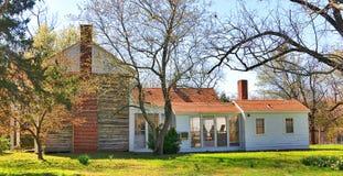 Sidosikt av huset för Davies säterikoloni Arkivbild
