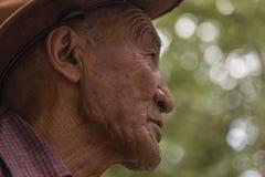 Sidostående av en gammal tibetan man Fotografering för Bildbyråer