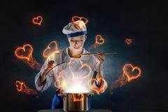 Sie ist Magier als Koch Stockfotografie