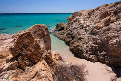 Sie view and a small beachbetween the rocks in Pinus Village. View of the calm blue sea in a sunny day from the cliffs. A small beach between the rocks in Pinus Stock Photo