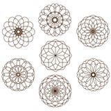 Sieben dekorative Kreisformen auf einem weißen Hintergrund Stockbilder