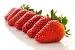 Sieben Erdbeeren gezeichnet Lizenzfreie Stockfotos