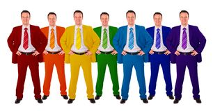 Sieben gleiche Geschäftsmänner in der unterschiedlichen Farbe entspricht Co Lizenzfreies Stockfoto