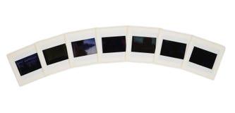 Sieben Plättchen in einem Lichtbogen Stockbild
