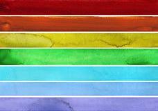 Sieben Regenbogen farbige Aquarellfarbenanschläge Lizenzfreie Stockfotos