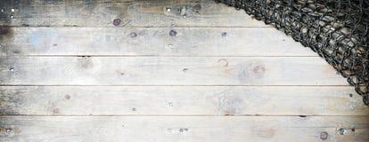 Sieci rybackiej życie na drewnianym tle Zdjęcia Royalty Free