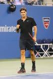 Siedemnaście czasów wielkiego szlema mistrz Roger Federer podczas ćwierćfinału dopasowania przy us open 2014 przeciw Gael Monfils Zdjęcia Royalty Free
