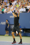 Siedemnaście czasów wielkiego szlema mistrz Roger Federer podczas ćwierćfinału dopasowania przy us open 2014 przeciw Gael Monfils Zdjęcie Royalty Free
