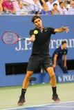 Siedemnaście czasów wielkiego szlema mistrz Roger Federer podczas ćwierćfinału dopasowania przy us open 2014 przeciw Gael Monfils Fotografia Royalty Free