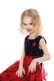 Siedząca uśmiechnięta mała dziewczynka Zdjęcie Stock