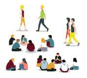 Siedzący i chodzący młodzi ludzie Fotografia Stock