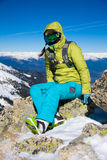 siedzący dziewczyny snowboarder Zdjęcie Stock
