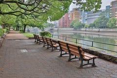 Siedzenie strona ota rzeką Obraz Stock
