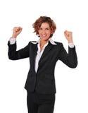 Sieg einer leistungsfähigen Geschäftsfrau Stockfoto