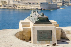 Siege Bell War Memorial in Valletta, Malta. View of the War sculpture by Michael Sandle from the Siege Bell War Memorial or Malta Siege Memorial at the entrance Stock Image