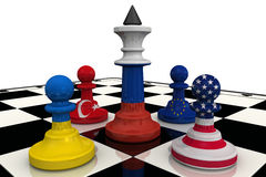 The Siege Of Russia. Chess pieces on the board - the king in the colors of the Russian flag surrounded by the pawns in colors of the flags of the United States Stock Images