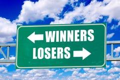Sieger- und Verliererzeichen Stockbilder