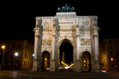 The Siegestor - Victory Gate in Munich at night, Germany stock photography