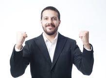Siegreicher junger Geschäftsmann Stockfoto