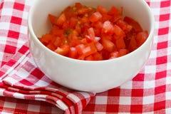 siekający pomidory zdjęcie royalty free
