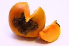 Siekająca Persimmon pojedyncza Owoc (Hebanu kaki) Zdjęcie Stock