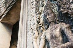 Siem Przeprowadza żniwa, Kambodża, Dec - 08 2016: Ulga przy Bayon świątynią w Ang Zdjęcia Royalty Free