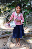 SIEM REAP, ANGKOR WAT/CAMBODIA - CIRCA AUGUST 2015: Young girl sells souvenirs to tourists outside of Angkor Wat  temple Royalty Free Stock Images