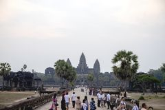 Siem Reap, Cambodia - 15 April 2018: tourists in Angkor Wat temple. People crowd going in Angkor Wat. Khmer architecture legacy. Tourist place of interest royalty free stock photography