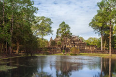 SIEM REAP, CAMBODIA.The Baphuon is a temple at Angkor Thom reflecting in the lake. Stock Photo