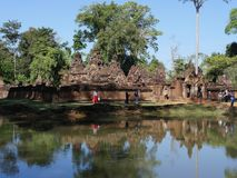 View of Banteay Srei from surrounding moat royalty free stock photo