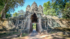 Siem Reap, Cambodia, December 06, 2015: The Bayon gate of Angkor Thom the ancient Khmer empire in Siem Reap, Cambodia. Stock Images
