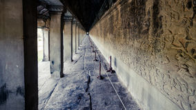 Siem Reap, Cambodia, December 06, 2015: A corridor with columns inside the Angkor Wat. Angkor Wat is one of the famous tourist att Stock Photo