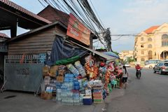 Huge number of boxes of all sorts of drinks and food near a small shop. Water bottles. Siem Reap, Cambodia, December 17, 2018 a huge number of boxes of all sorts stock image