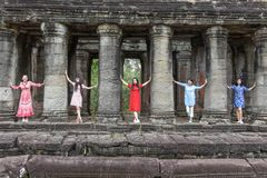 Women posing at ancient Preah Khan temple in Angkor, Cambodia Stock Photography