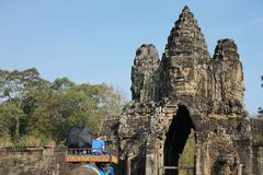 Tourists pass the south gate of Angkor Thom on an elephant royalty free stock images