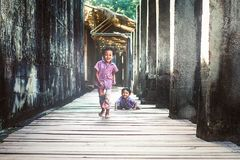 Little boys in Angkor Wat. Siem Reap, Cambodia - July 14, 2013: Little boys playing and smiling in the ruins of an old temple in Angkor Wat Royalty Free Stock Photography