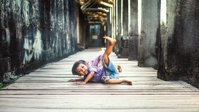 Young boy in Angkor Wat. Siem Reap, Cambodia - July 14, 2013: Young boy playing in the ruins of an old temple of Angkor Wat Royalty Free Stock Image