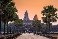SIEM REAP, CAMBODIA - MARCH 8, 2017: Tourists visiting the Angkor Wat complex. Angkor Wat is the largest religious monument in the stock photography