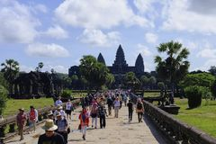 SIEM REAP, CAMBODIA - NOVEMBER 9, 2017: Angkor Wat temple view with tourists Royalty Free Stock Photography