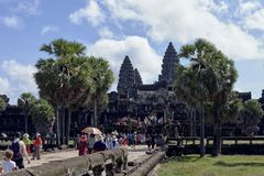 SIEM REAP, CAMBODIA - NOVEMBER 9, 2017: Angkor Wat temple view with tourists Royalty Free Stock Photo
