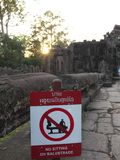 No sitting on balustrade-Notice at Banteay Kdei. Siem Reap-December 23, 2017:No sitting on balustrade-Notice at Banteay Kdei royalty free stock photos